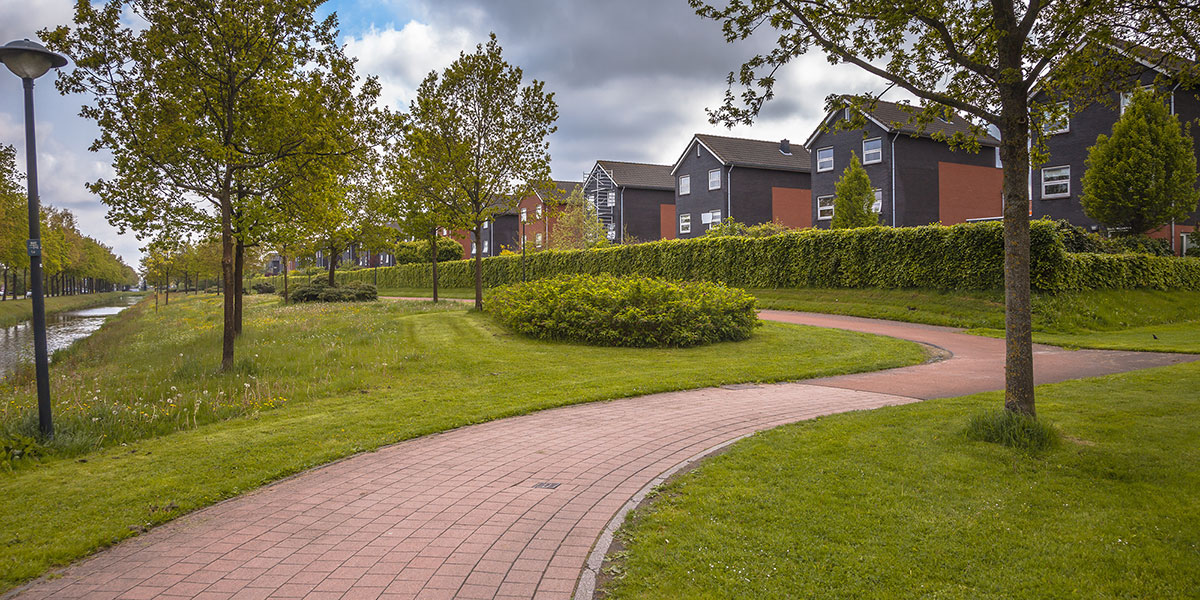 Winding brick path through a park in a residential townhouse complex