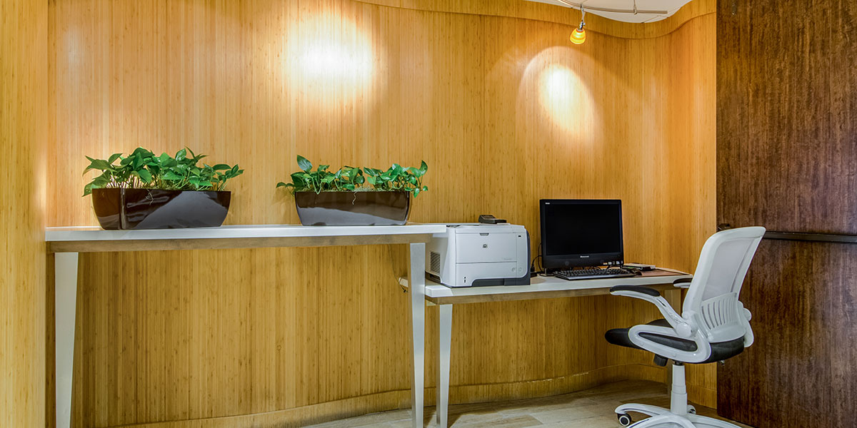 Business center in a hotel with laptop and printer