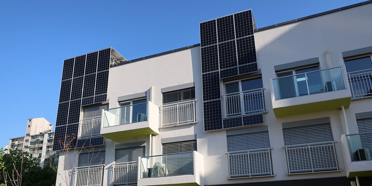 Solar panels on the exterior of an apartment building